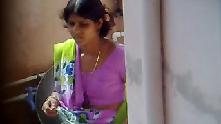 Indian wife at home washing stuff
