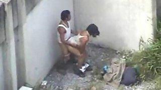Couple enjoying sex in open