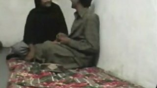 Pakistani couple enjoying sex in their bedroom