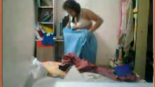 Mature housewife changing her clothes in her room