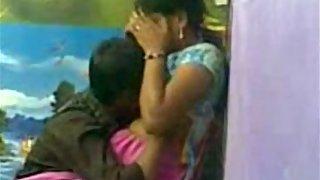 Bihari young college couple in a friend studio kissing