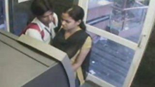 Couple kissing in telephone buth
