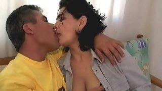 Mature Arab couple having sex in their bedroom.