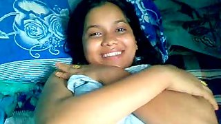 Shy Indian girl covering herself with bedsheet