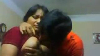 Busty juicy bhabhi getting her boobs sucked by her hubby