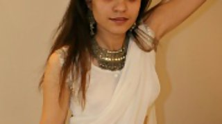 jasmine in white Indian saree looking hot teasing her man