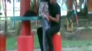 desi couple in park kissing